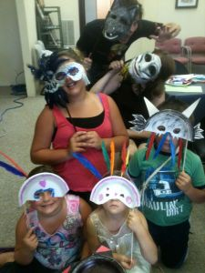 Youth participating in the Improv: Theater @ The Theater! Youthshop masquerade in their self-made props.